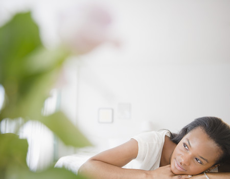 Tranquil Black woman thinking LANG_EVOIMAGES