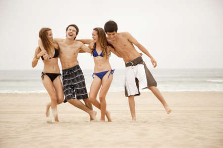 Teenagers hanging out together on beach
