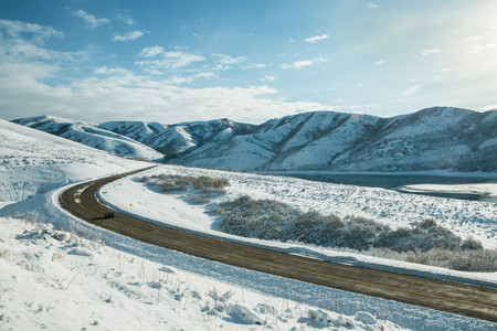 Road through snow covered valley LANG_EVOIMAGES