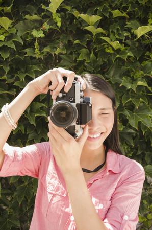 Asian woman taking photographs