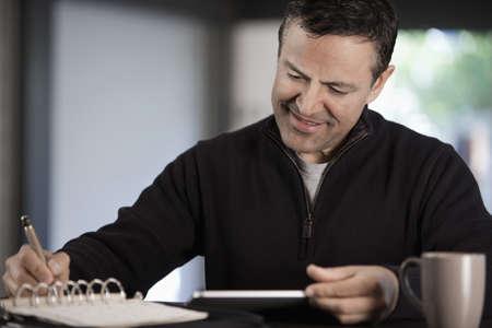 Hispanic businessman working with digital tablet