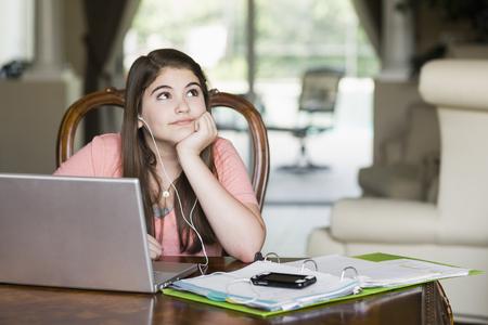 Bored Caucasian girl doing homework