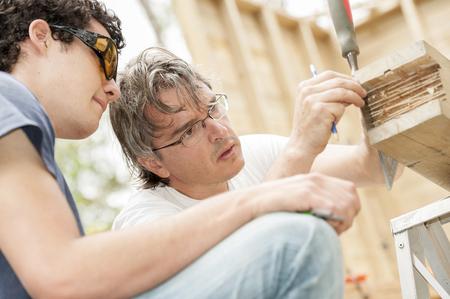 Hispanic carpenters working with wood