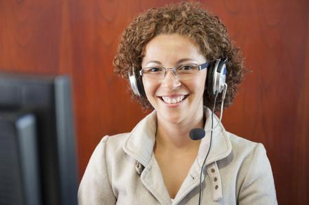 Hispanic businesswoman in headset LANG_EVOIMAGES