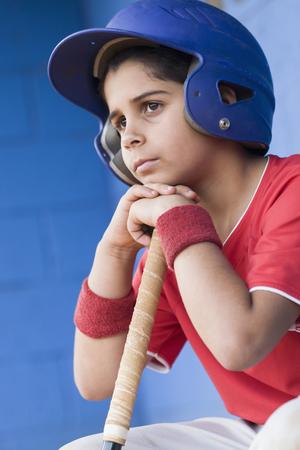 Sad Hispanic baseball player
