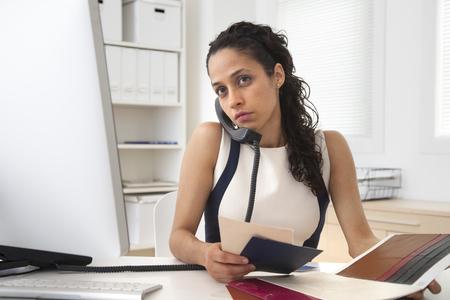 Hispanic businesswoman talking on phone