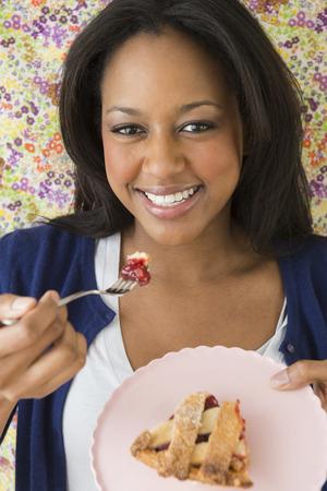 African American woman eating dessert