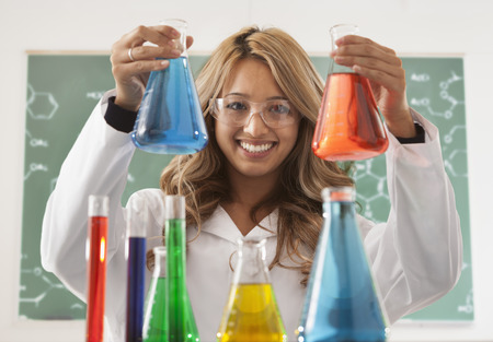 Mixed race student working in chemistry lab