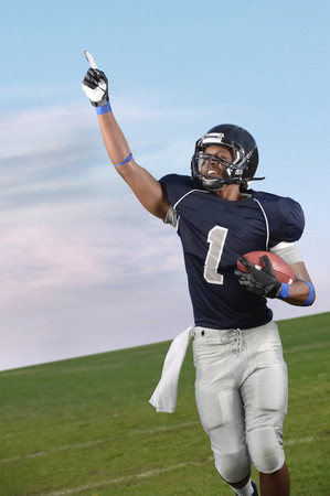 African American football player cheering in game LANG_EVOIMAGES