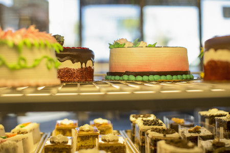 Close up of cakes in pastry case