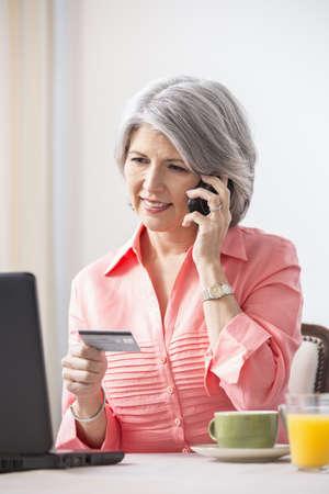Caucasian woman shopping on telephone