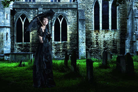 Pacific Islander woman in black gown in graveyard LANG_EVOIMAGES