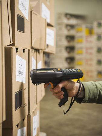 Hispanic worker scanning boxes in walk-in freezer LANG_EVOIMAGES