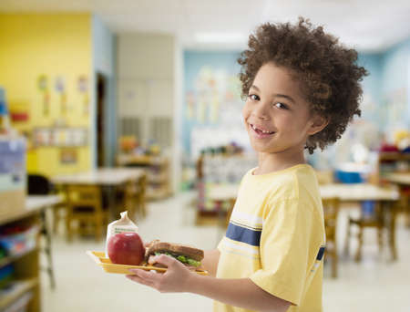 Mixed race boy having lunch in classroom LANG_EVOIMAGES