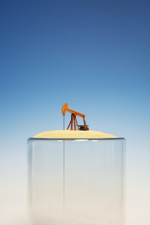 Oil pump on top of empty glass LANG_EVOIMAGES