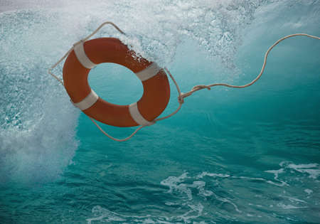 Life ring tossing in waves LANG_EVOIMAGES