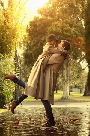 Caucasian couple hugging in park LANG_EVOIMAGES