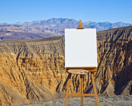 Artists Easel and Canvas in Desert LANG_EVOIMAGES