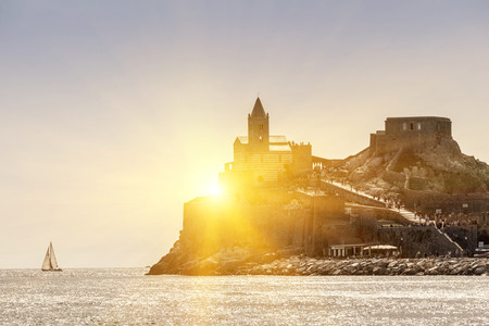 Sun rising over castle on island,Portovenere,Liguria,La Spezia,Italy
