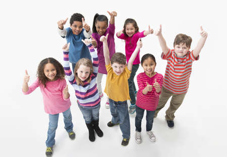 Children giving thumbs up together