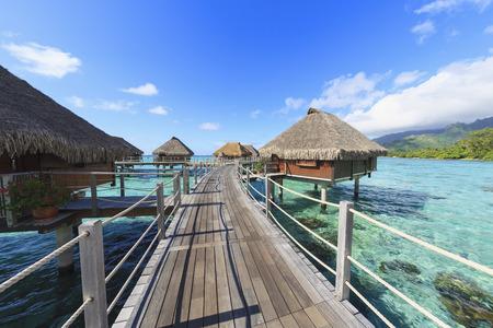 Decks connecting bungalows over tropical ocean,Bora Bora,French Polynesia