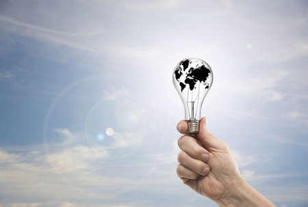 Caucasian man holding globe light bulb LANG_EVOIMAGES
