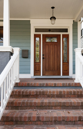 Brick steps and front door of house LANG_EVOIMAGES