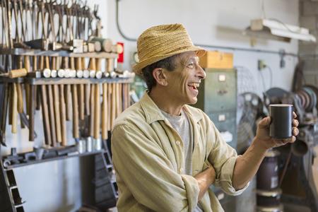 Middle Eastern man smiling in workshop