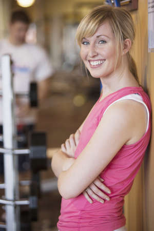 Caucasian woman smiling in gym
