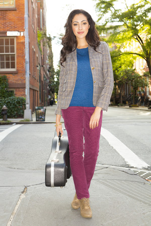 Mixed race woman carrying guitar case LANG_EVOIMAGES
