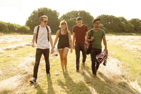 Friends walking together in rural landscape