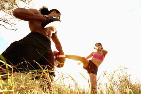 Kickboxer training in rural field