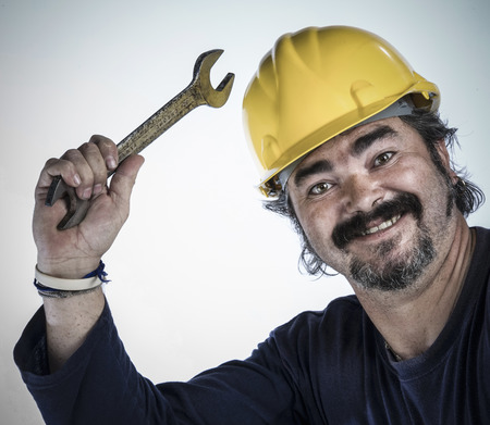 Construction worker holding wrench