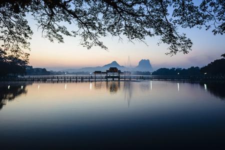 Sunrise over mountains and lake, Hp-Aan, Kayin, Myanmar LANG_EVOIMAGES