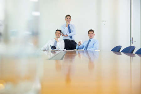 Businessmen smiling in office