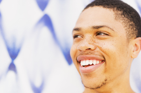 Close up of African American man smiling LANG_EVOIMAGES