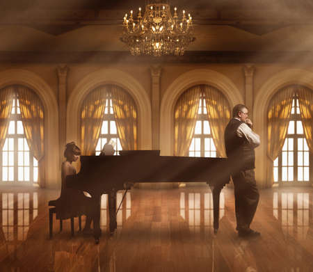 Caucasian music teacher listening to student at piano in ballroom LANG_EVOIMAGES