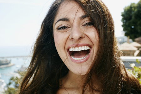 Close up of mixed race woman laughing LANG_EVOIMAGES