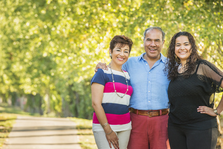 Hispanic family smiling together outdoors