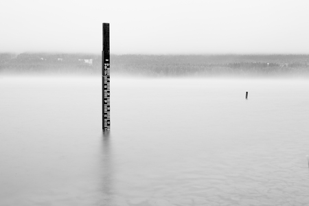 Wooden measuring post in water LANG_EVOIMAGES