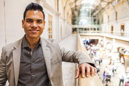 Hispanic businessman standing on upper level