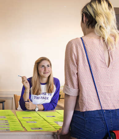 College student volunteer working at orientation for new students