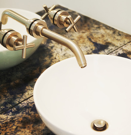 Close up of sink and faucet in modern bathroom