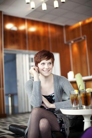 Smiling Caucasian woman in restaurant