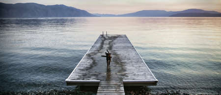 Dog standing on pier in tranquil lake