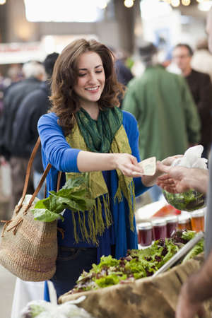 Hispanic woman shopping for food in farmers market