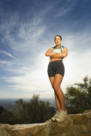 Hispanic woman hiking in remote area LANG_EVOIMAGES