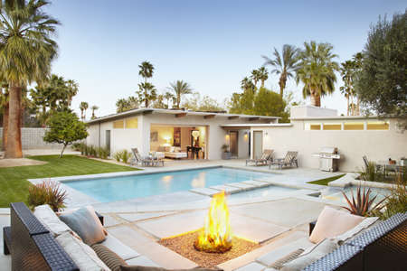 Modern patio, seating area, fire pit and swimming pool LANG_EVOIMAGES