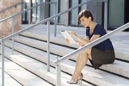 Caucasian Businesswoman Using Digital Tablet On Staircase