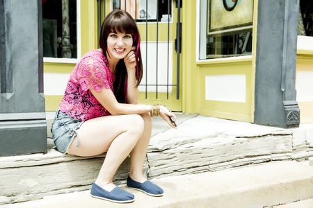 Caucasian Woman Smiling On Front Stoop